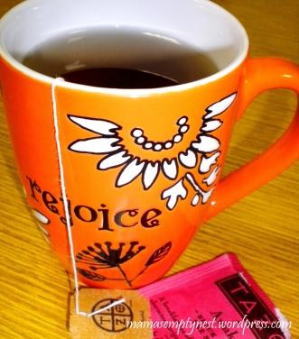 Mmm...hot tea in an orange cup!