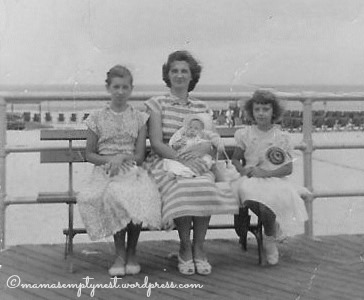 Three sisters with our mother (I'm the baby on her lap)